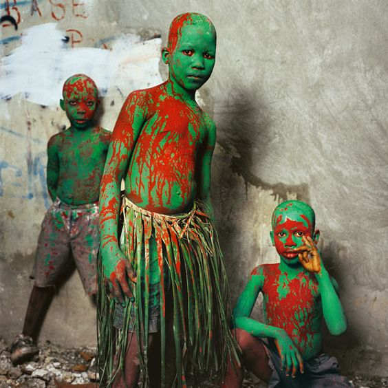Haiti during the spring carnival. In the Haitian port city of Jacmel three boys become Pa Wowo—painted, coconut-leaf-skirted peasants who personify poverty—for the spring carnival.