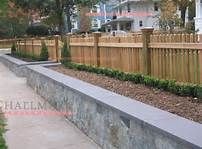 retaining wall bench next to a fence - Bing Images