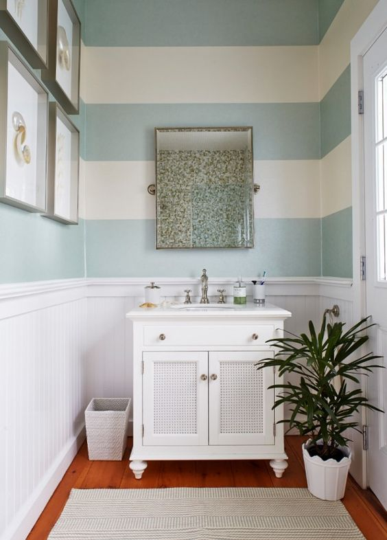 Horizontal Stripes in the Bathroom & removed the wood panels in the vanity and add metal panels.