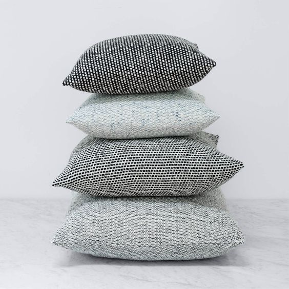 Made from pure merino wool, this pillow is a mid-century minimalist's dream. Each one is hand-loomed with yarns that create a chunkier, more tactile weave.
