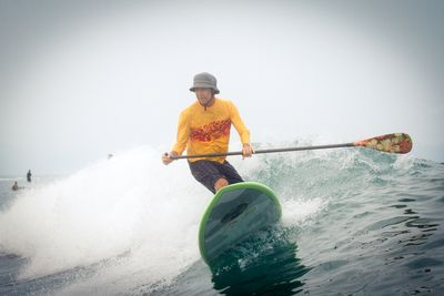 SUP (Stand up paddle board) Surfing by Gerry Lopez - Surf Legend.