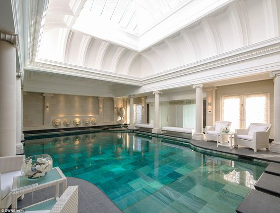 The house includes a steam room, gymnasium and a huge swimming pool room with vaulted ceiling and graduated pool