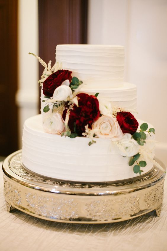 Pinterest: alex_ramey. Wedding cake with flowers. Marsala and blush flowers.::