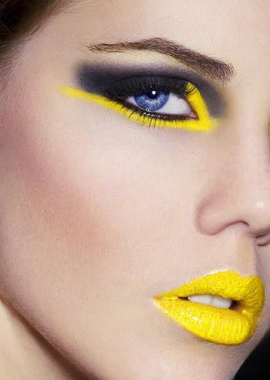 Cool yellow lipstick and eye makeup and black liner/ shadow.