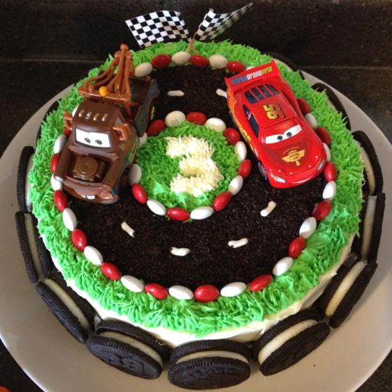 Cars birthday cake with donuts tires instead of oreos around