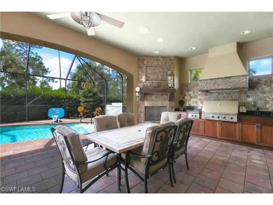 Outdoor dining on the lanai with gas fireplace and decor