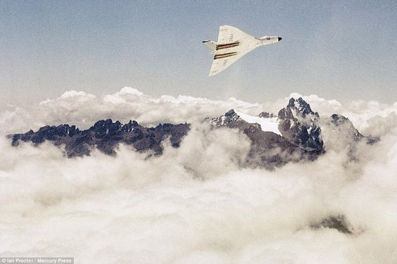 Dramatic: Away from British shores, a Vulcan B1 XA912  flies over Mount Kenya during a flight to Nairobi in July 1960
