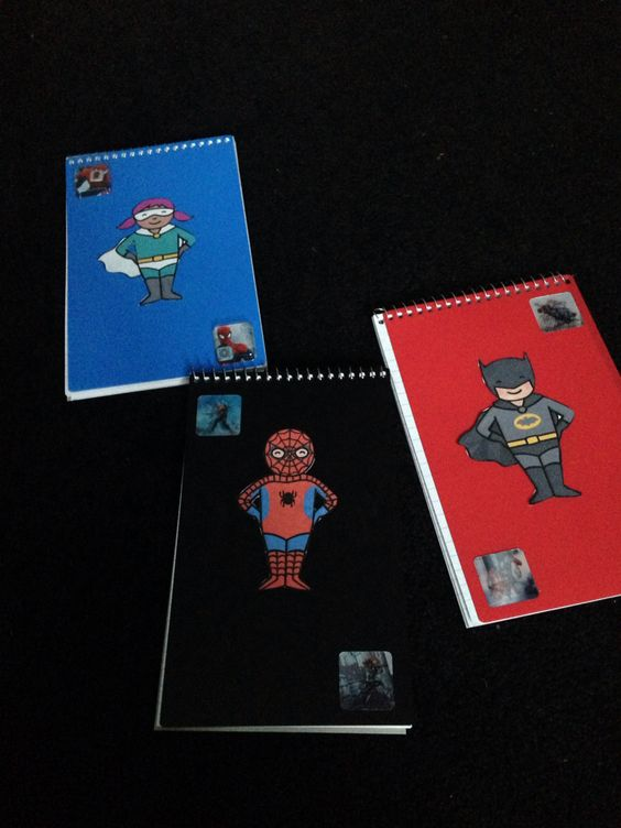 Superhero notebooks I made - super cheap. Notebooks from asda & added the superhero stuff on myself