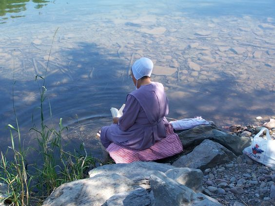 Amish Solitude. I love this picture; there's something wonderful about reading on a hot summer day with your feet in a nice cold river.