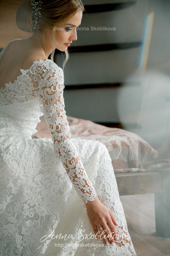 Wedding dress with V back cut from luxurious dense lace