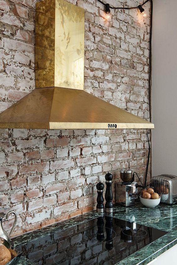 brass vent in kitchen/brick backsplash/brick wall/Kastellgatan 6, Elegant apartment in Göteborg