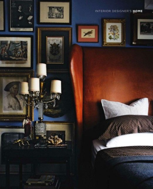 leather headboard and dark blue wall.: