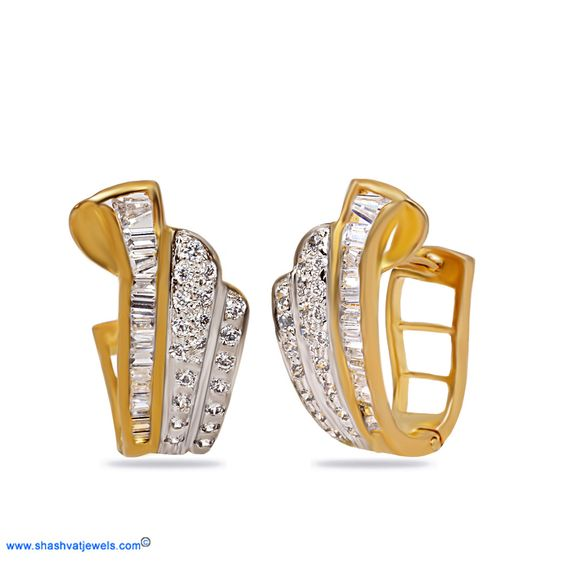 A lovely medley on connecting smooth lines and twinkling precious stones, this chic pair of earrings is modern and stylish. Ideal for both Western and Indian wear this stunning pair makes a smooth transition from day to evening wear. #diamond #earring #hoops http://www.shashvatjewels.com/ProductDetail.aspx?prdid=568&name=Alethia%20Hoop%20Earrings All our desings are available in white gold and silver also..!!