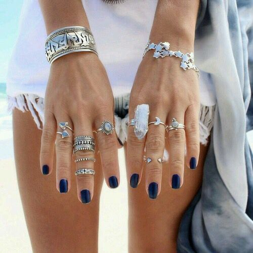 Silver rings & bracelets jewelry & navy fingernail polish