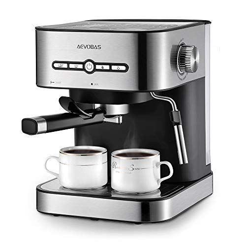 Coffee cups on professional espresso machine in the morning