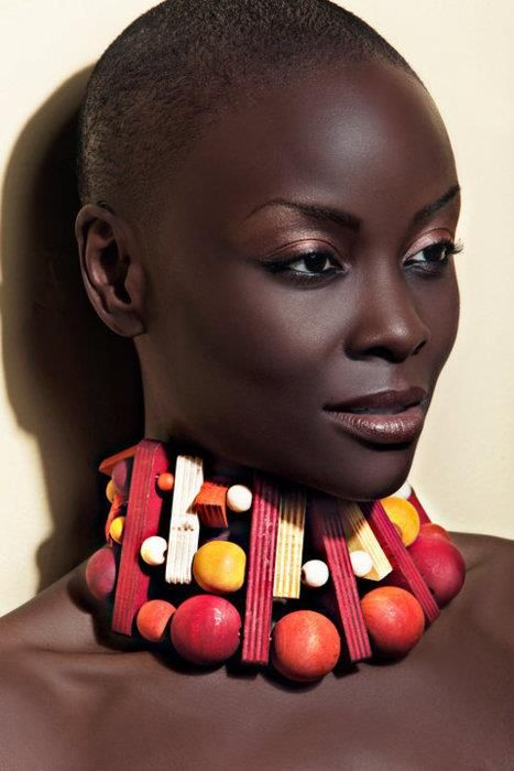 """Kenyan supermodel Ajuma Nasenyana is fighting skin lightening and European standards of beauty. """"It seems that the world is conspiring in preaching that there is something wrong with Kenyan ladies' kinky hair and dark skin,"""" she told Kenya's Daily Nation Newspaper."""