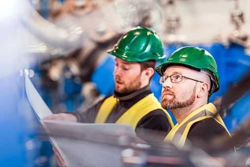 Stock Photo : Manufacturing professionals with document in factory