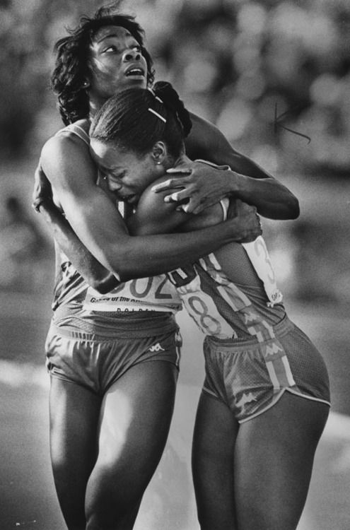After winning the 100 meters in the Los Angeles Olympics, Evelyn Ashford (right) hugs teammate Jeanette Bolden. August 6, 1984. In addition to the 100 m, Evelyn won the 4 x 100 m relay in 1984. She returned to the Olympics in 1988 and 1992, winning two gold medals in the 4 x 100 m relay and a silver medal in the 100 m. Jeanette only won one gold medal, her career ended when she ruptured her Achilles tendon at the 1988 Olympic trials. Today she is a track and field coach at UCLA.