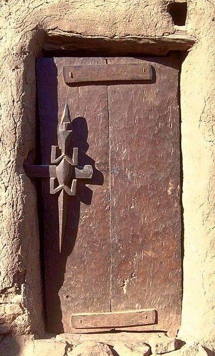 Africa   A Crocodile door lock/handle on a Dogon door. Mali