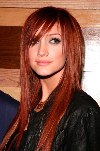 Sleek and straight in a rich red color with a long side-swept fringe,