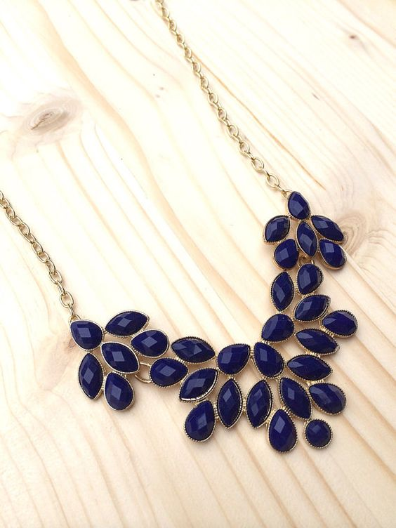 Need navy statement necklace to go with dress. My dress is coral with navy damask pattern. Strapless.