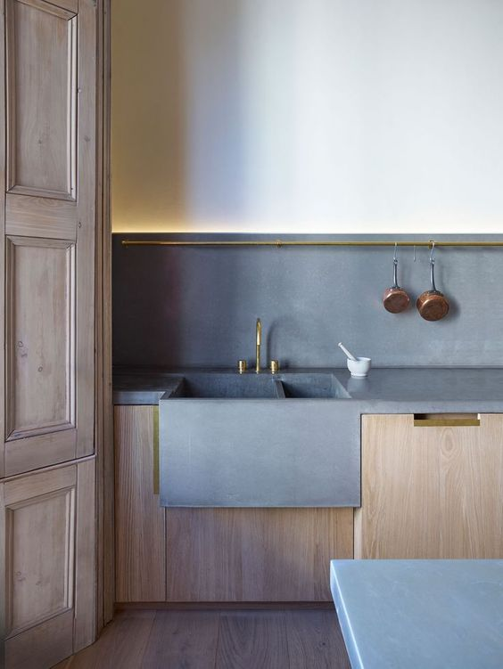 kitchen - timber cabinetry and poured concrete bench tops, splash back and sink