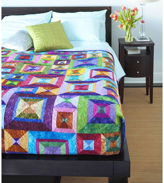Rainbow colors & batiks....two of my favorites in one awesome quilt!