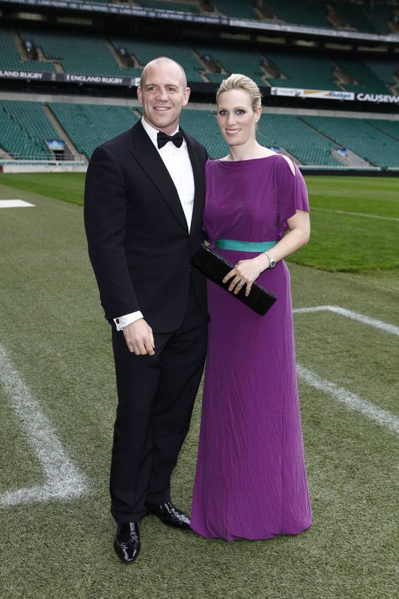 ZARA TINDALL, 2012 Princess Anne's daughter, Zara Tindall wore a deep purple gown with a belt to the Rugby For Heroes Charity Gala Dinner at Twickenham Stadium, which she attended with her husband, Mike Tindall.