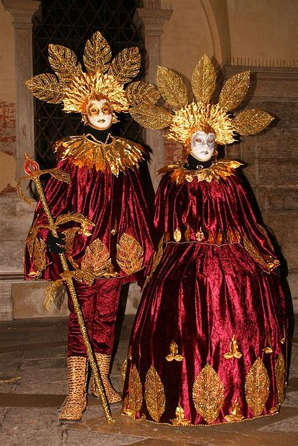 Couple dressed in ruby red and gold 'leaves'... amazing headdresses from  Venice Carnival | by David Pin