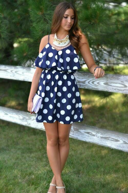 Very cute! Blue dress with white polka dots.