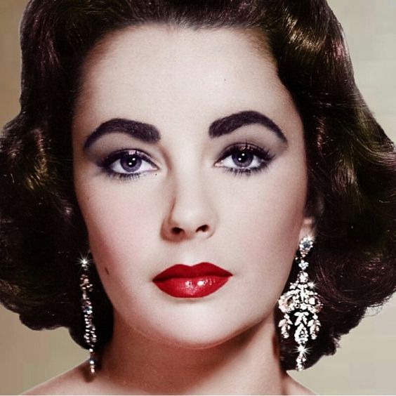 Liz Taylor. She's beautiful and her eyes look purple ...
