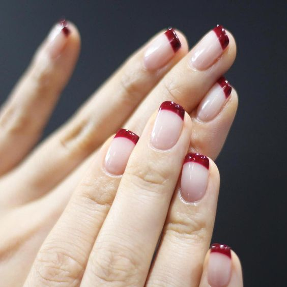 The French manicure is making a comeback on everyone from Kim Kardashian to Bella Hadid. Here are the coolest new French manicure ideas. #frenchtipnail