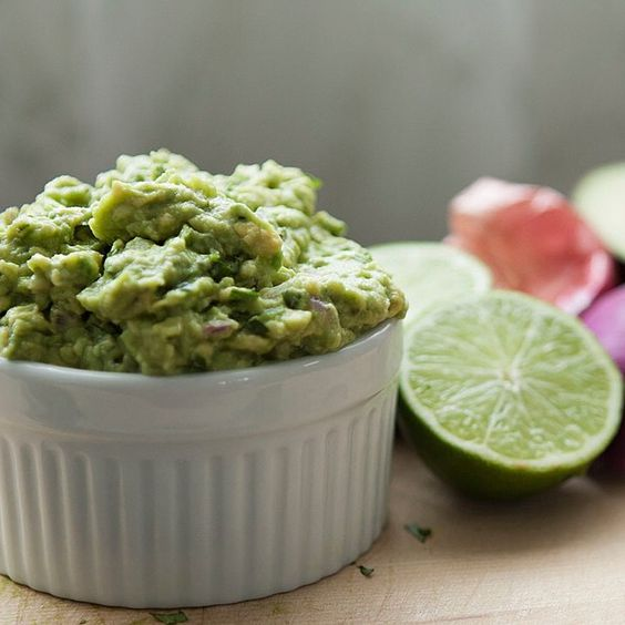 """""""KAY'S AWESOME GUACAMOLE RECIPE Here's a homemade, fresh guacamole from my lovely wife Kay that will compliment the carne asada recipe I posted earlier.  It's amazingly good, with a true authentic Mexican feel to it.  This is a very simple recipe…avocado, onion, garlic, lime, cilantro, salt, pepper…and love.  INGREDIENTS 2 large avocados 1/4 medium red onion, finely chopped juice from 1/2 lime 2 cloves of garlic, minced 1/4 cup cilantro, chopped 3/4 tsp Kosher salt or sea salt 1/2 tsp fresh…"""