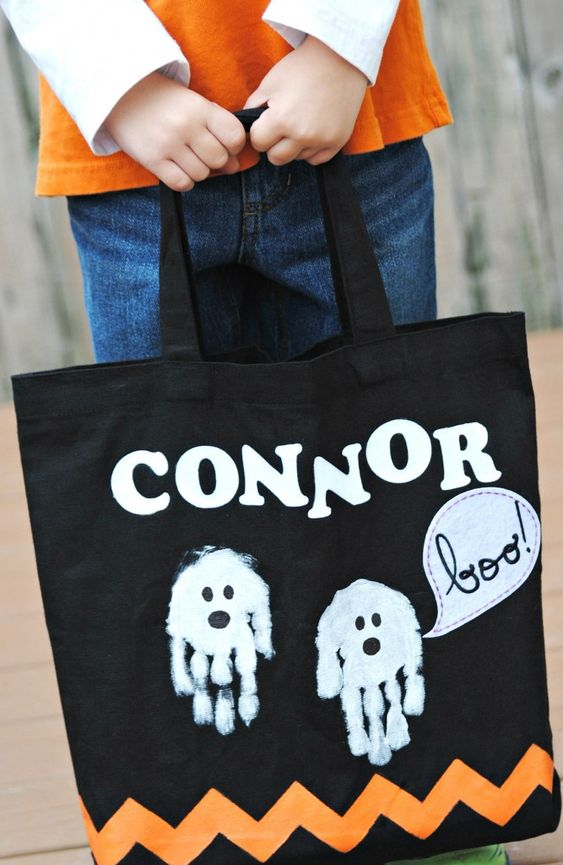This hand made Halloween trick or treat tote bag is personalized with your child's name and hand print ghosts!