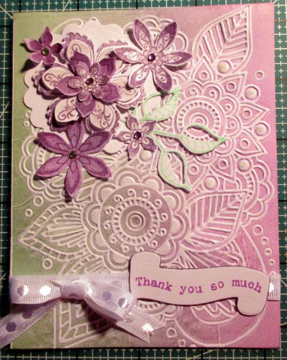 Used a Darice embossing folder 4 different ways.  Inked the folder with a brayer and Big and Juicy ink pad.