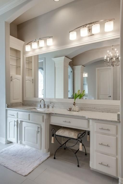 Traditional Master Bathroom with High ceiling, Crown molding, Carpet, limestone tile floors, Built-in bookshelf, Wall sconce
