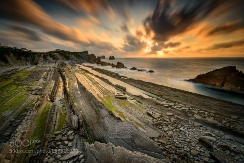 Playa La Arnía by lcagiao  sky sea sunset water beach sun clouds coast ocean rocks mar seascape spain long exposure playa canta