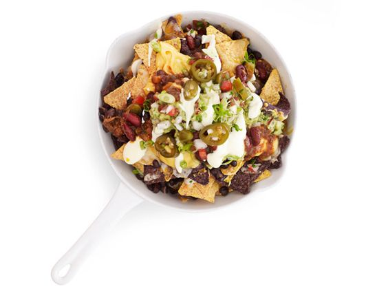 Nachos With Cheese Sauce  Crunchy tortilla chips are topped with prepared chili, guacamole, jalapeno slices and a gooey cheddar cheese sauce, flavored with garlic and shallots.  Having these for Movie Night tonight!