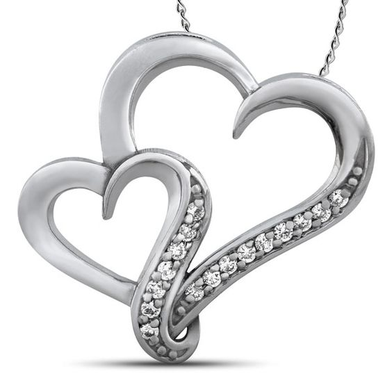 New to The Jewelry Exchange this beautiful .10 carat total weight Two Hearts That Beat as One™ diamond pendant set in 10k white gold