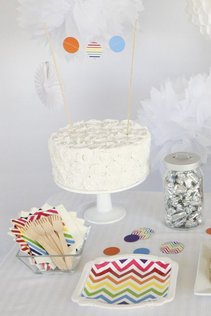 Cake and tableware at a Chevron Rainbow Birthday Party!  See more party ideas at CatchMyParty.com!