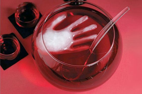 Freeze a rubber glove filled with water and put it in the Halloween punch bowl - it will scare your guests and keep the punch cool!