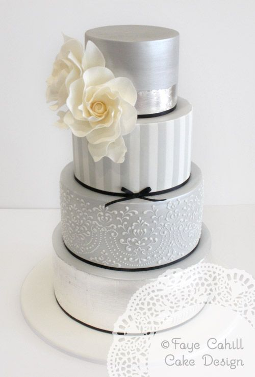 Beautiful Grey Cake   Faye Cahill Cake Design. Would be cute with all the light blue, or each layer is a different color from your wedding colors :)