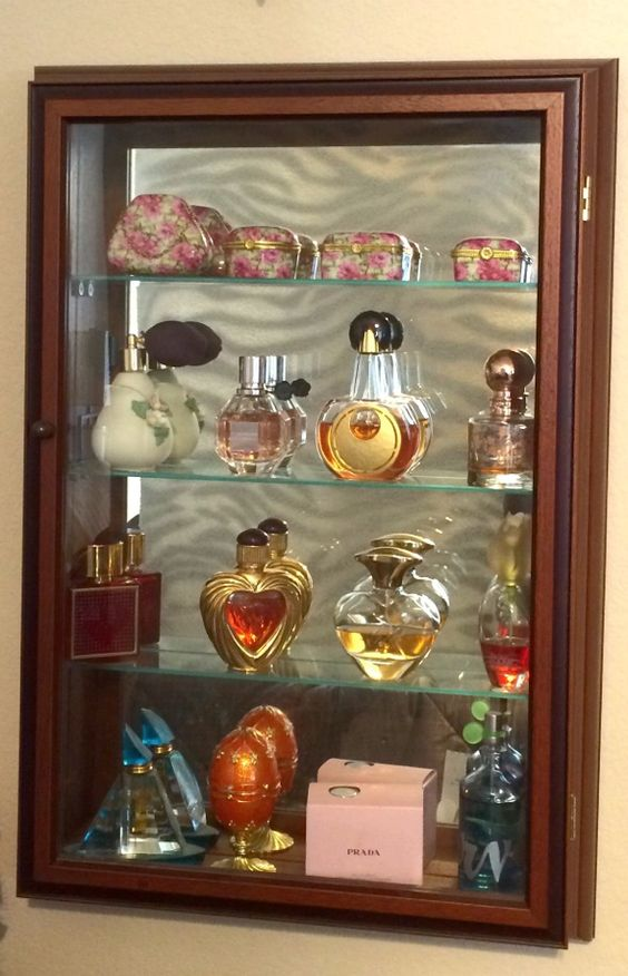 Other ways to use a mirrored wall curio...perfume organizer.