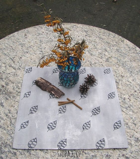 A tiny tablecloth with leafs