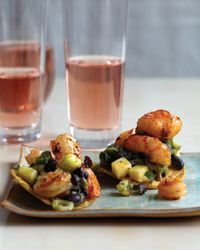 """Tequila-Flamed Shrimp Tostadas Recipe on Food & Wine """"I created this dish late one night when I was hungry and tired of my menu,"""" Sue Torres says. """"The tequila adds a little smokiness to the shrimp, and I liked the great textural difference between the creamy avocado and the crispy tostada."""""""