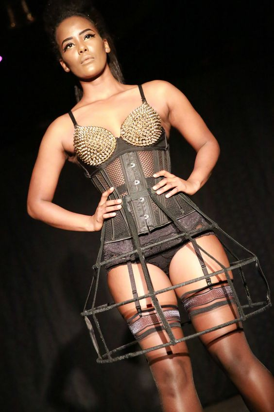 Spiked bra and corset with Custom made cage skirt  WAISTED LACE CORSETS  photo : Jason Matz