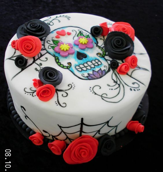 Have been wanting to try painting on fondant for a while. This is for my daughter who loves Sugar Skulls.Roses are sugarpaste.: