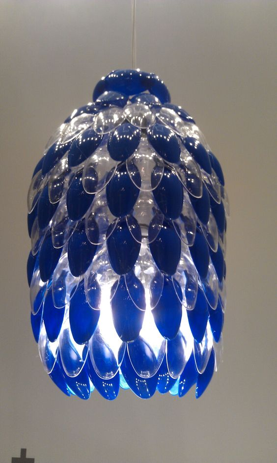 Brian howell denver art museum lamp made of recycled for Plastic spoon lamp video