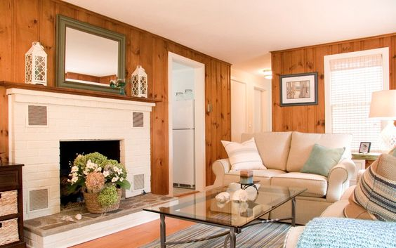 more good knotty pine  white fire place and white moldings leaving the knotty pine walls...light decor