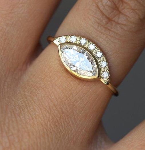 Marquise diamond engagement ring with cool halo style